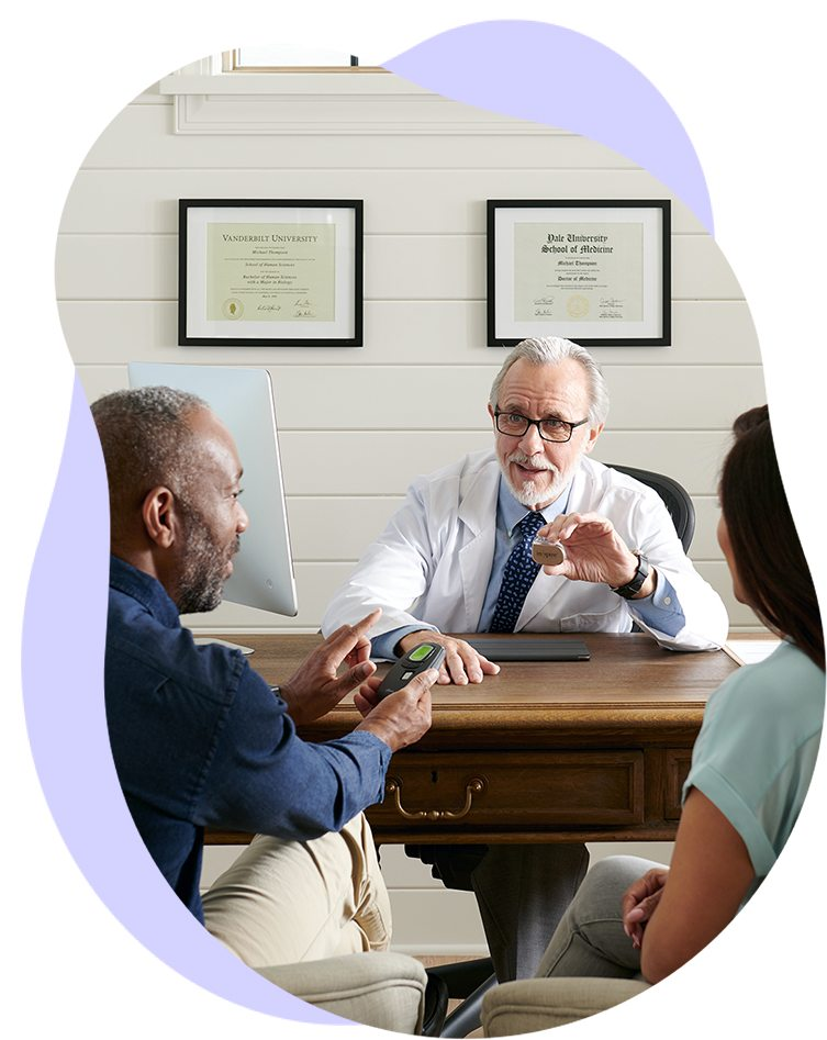 A couple consults an Inspire trained doctor about their treatment