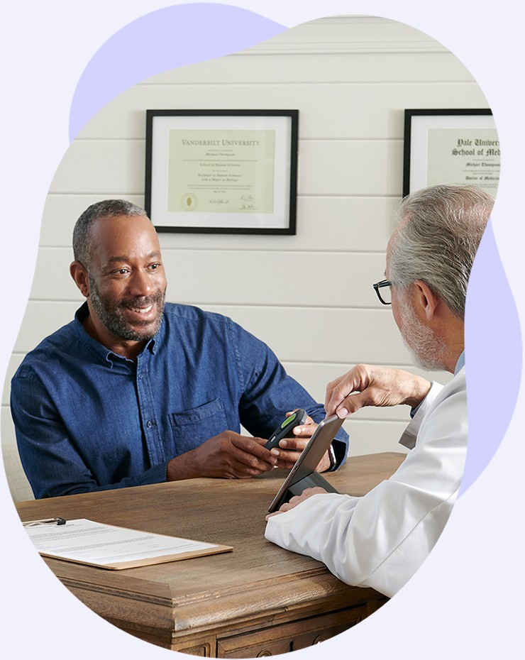 A patient discusses sleep apnea treatment with an Inspire trained doctor